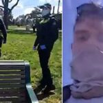 Tense moment Victorian cops confiscate a 'free Melbourne' sign from two friends out for a walk because 'you don't have the right to protest' during Stage Four lockdown